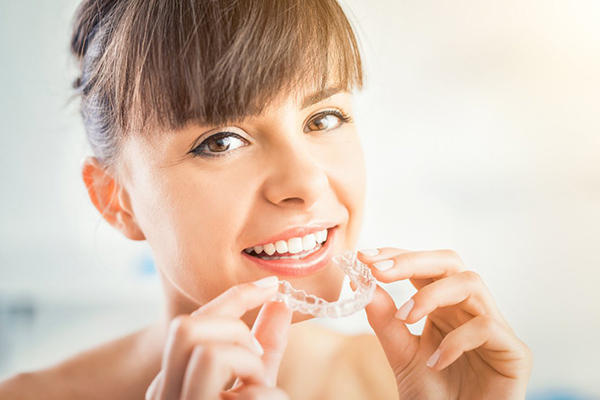 Woman using Invisalign