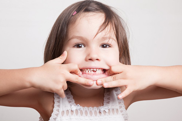 Child showing her teeth